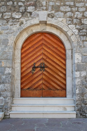 Wooden door entrance to the citadel in Budva, Montenegro photo