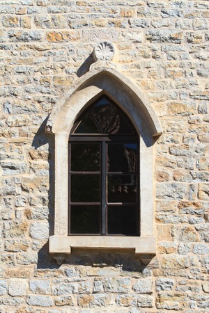 Fancy window with an arch in the old town of Budva. Montenegro photo