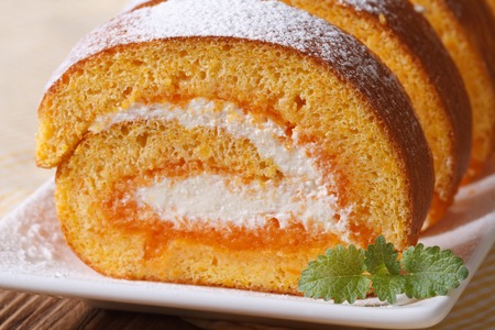 pumpkin roll with cream cheese and jam. macro horizontal photo