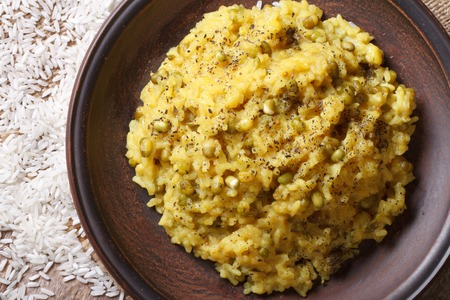 indian bean: Indian Food: Khichdi with rice and mung bean on a plate close-up. top view horizontal