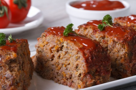 Beef Meat Loaf Closeup sliced on a plate, horizontal photo