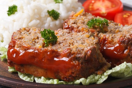 meat loaf with rice and vegetables on a plate macro horizontal photo