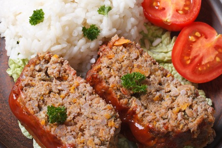 meat loaf with rice and vegetables on a plate macro horizontal view from above photo