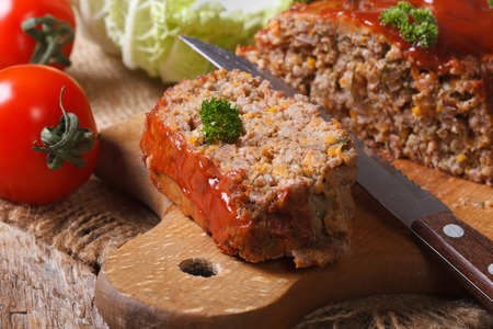 meat loaf with vegetables close-up on a cutting board. horizontal photo