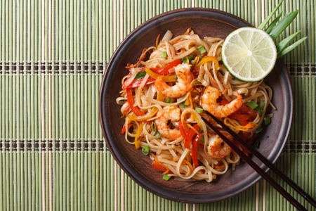thailand view: Delicious rice noodles with shrimp close-up on a plate