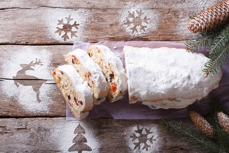 Stollen German Christmas cake cut on the table. horizontal view from above photo