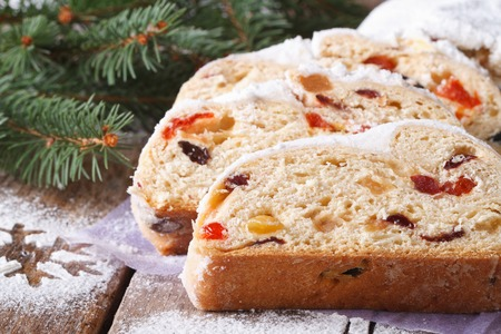 Christmas fruit bread Stollen close-up on the table. horizontal, rustic style photo