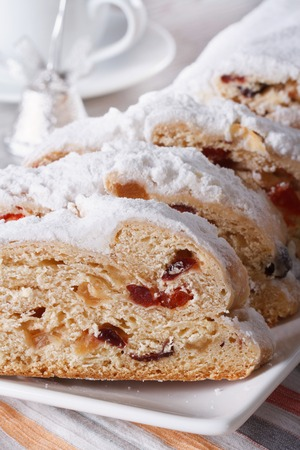 Delicious fruit cake German Stollen closeup on a plate. vertical photo