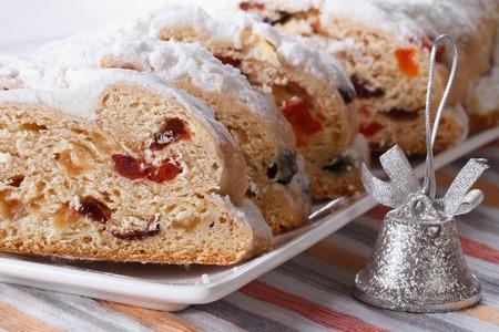 Tasty German Christmas fruit cake Stollen closeup on a white plate. horizontal photo