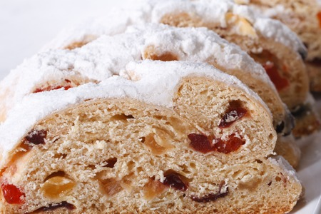 Traditional fruit bread sliced macro on a white plate. horizontal photo