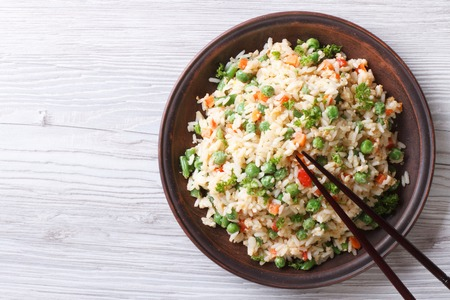 cooked rice: Japanese fried rice with green peas and eggs on the table. horizontal view from above Stock Photo