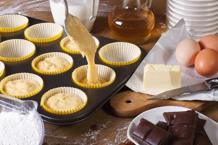 vanilla cupcake: The process of preparing cupcakes in the kitchen, ingredients closeup horizontal