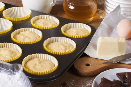 Preparation of vanilla muffins close-up in the kitchen. horizontal photo