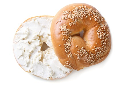 bagel with sesame and cream cheese isolated on white background. top view Фото со стока