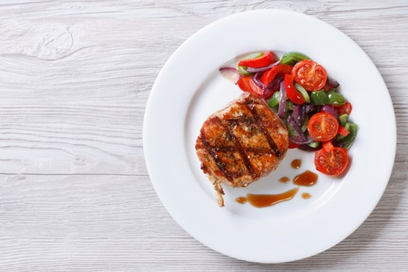 Fried piece of pork with vegetable salad on a plate close-up view from above. horizontal Stock fotó - 34981064