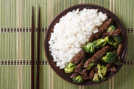 japanese food: beef with broccoli and rice on a plate close-up. horizontal view from above Stock Photo