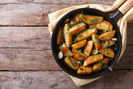sweet potatoes: potatoes fried in a pan, rustic style, horizontal view from above