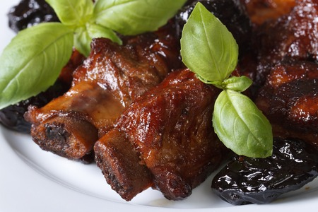 Pork ribs stewed with prunes macro. horizontal view from above photo