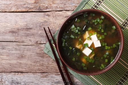 Japanese miso soup with tofu on the table. top view of a horizontal