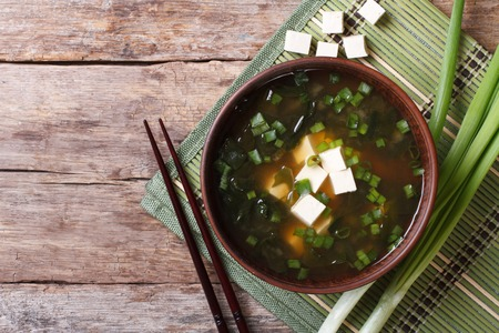 Japanese miso soup in a brown bowl on the table. horizontal view from above 스톡 콘텐츠