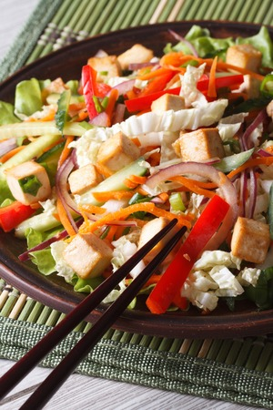 fresh vegetable: Dietary salad with tofu and fresh vegetables close up on a plate. Vertical