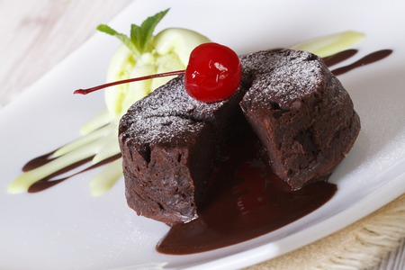 Delicious chocolate cake fondant with cherry closeup on a plate. horizontal Stock Photo