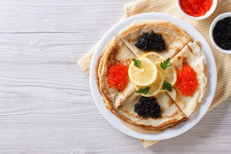 pancake: Pancakes with red and black caviar, horizontal view from above