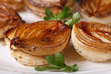 spanish onion: delicious caramelized onions in balsamic vinegar on a white plate macro. horizontal Stock Photo