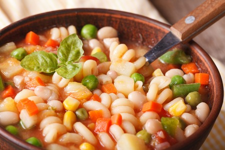 minestrone: Italian vegetable minestrone soup in a bowl macro. Horizontal Stock Photo