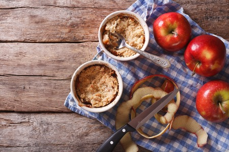 apple crumble: Traditional apple crumble in the pot on the table. horizontal view from above, rustic style