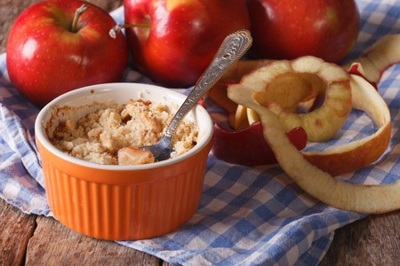 apple crumble: Delicious apple crumble close-up in a pot. Horizontal rustic style