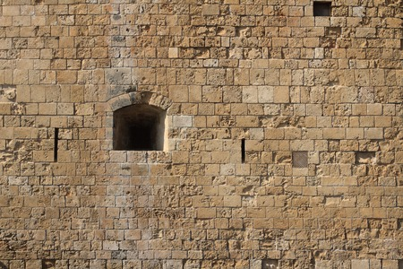 loophole: Loophole in castle close-up horizontal. Cyprus Paphos Stock Photo