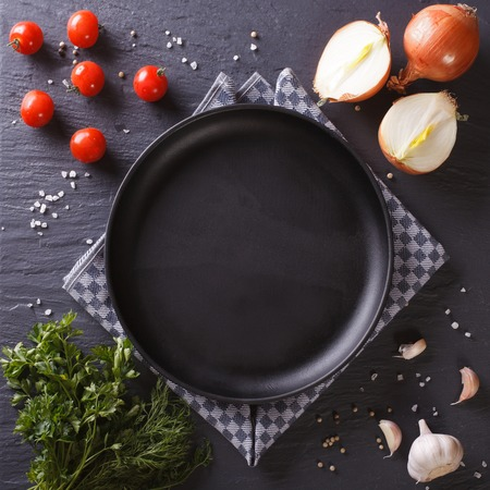 black dish: Menu: Set of vegetables and spice for cooking. Stock Photo