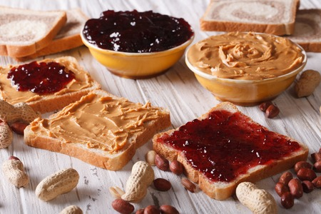Sandwiches with peanut butter and jelly on the table. horizontal