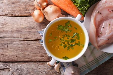 Country style: the chicken broth and the ingredients on the table