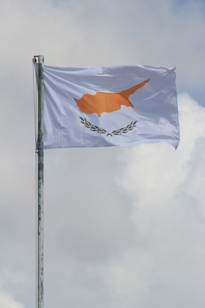proclaimed: Waving flag of Cyprus on a flagpole against the sky
