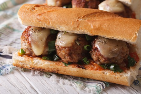 cooked pepper ball: Tasty sandwich with meatballs and sauce close-up on the table Stock Photo