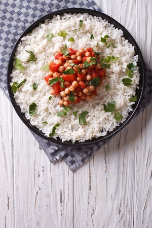 bowl with rice: Rice with chickpea and parsley on the plate