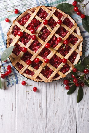 American homemade cherry pie on the table. vertical top view photo