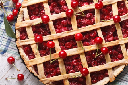 cherry pie and ripe berries close-up on the table. Horizontal top view photo