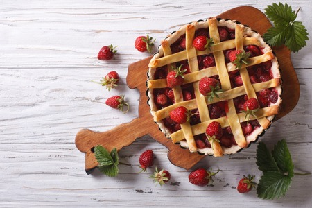 homemade strawberry pie on a table. horizontal view from above, rustic style photo