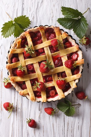 country christmas: Strawberry pie with fresh berries in a baking dish. vertical top view