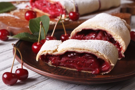 cherry pie: Sliced homemade strudel with cherry close-up on a plate. horizontal Stock Photo
