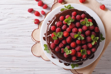 Chocolate cake with fresh raspberries and mint on the table Stock Photo
