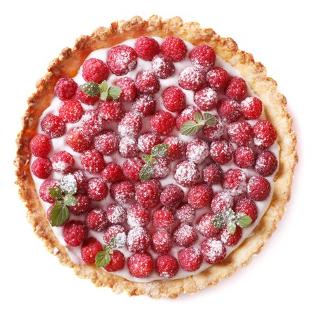 cakes and pastries: Tart with fresh raspberries and mint close-up isolated on white background