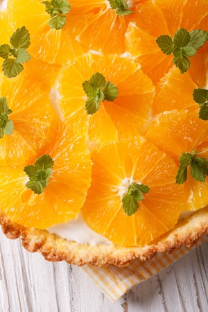 orange tart: Orange tart with a delicious cream and mint macro on the table. vertical top view