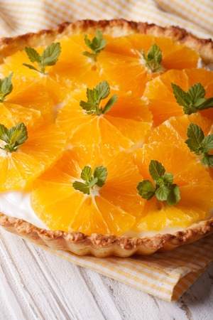 orange tart: Orange tart with a delicious cream and mint close-up on the table