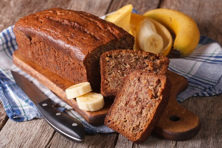 Homemade banana bread sliced on a table close-up. horizontal, rustic style 스톡 콘텐츠