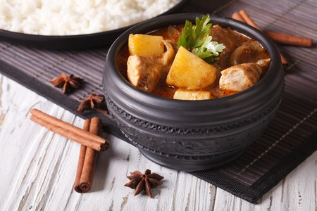 chicken soup: Traditional massaman curry with chicken in a bowl and rice on the table. horizontal