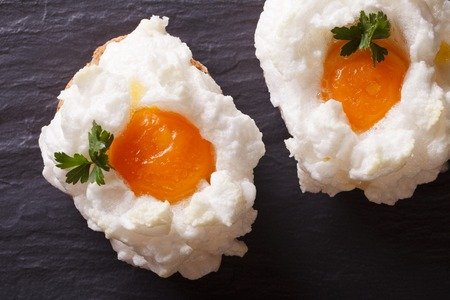 yolks: Eggs Orsini: baked whipped whites and yolks on a table close-up. horizontal view from above